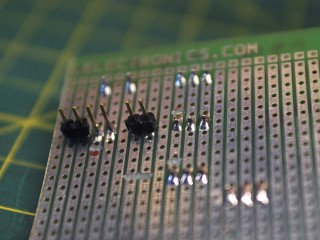 Soldering the pins and cutting the traces