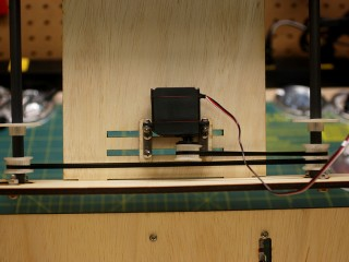 Adjustable servo mount and dual belt drive