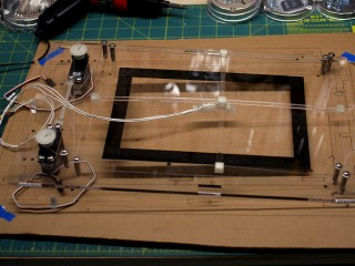 Plexiglass front panel – Servos strung with beading wire